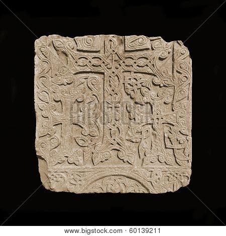 Vintage, Armenian medieval cross stone on the peninsula Sevan isolated on black