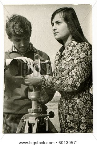 KURSK, USSR - CIRCA 1976: An antique photo shows portrait of two photographers (boy and girl) during a photocall