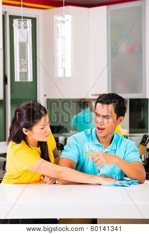 Young Asian handsome couple having relationship difficulties with alcohol problems and domestic violence
