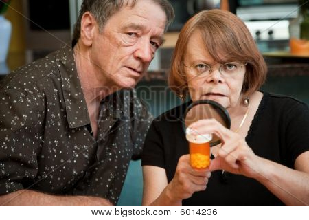 Senior Couple Examining Medications