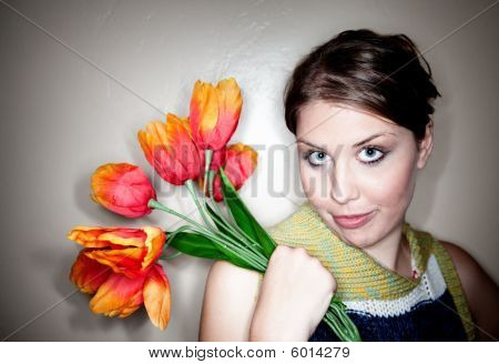 Pretty Young Woman With Plastic Flowers
