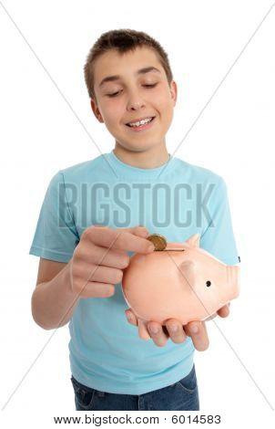 Boy Dropping Coin Into Money Box