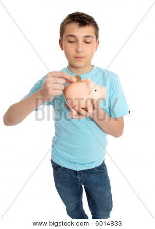 Child Placing Coins Into A Piggy Bank