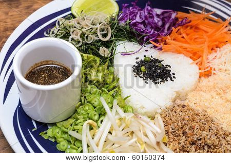 Nasi kerabu - Rice with herbs and vegetables Southen Thai-Style