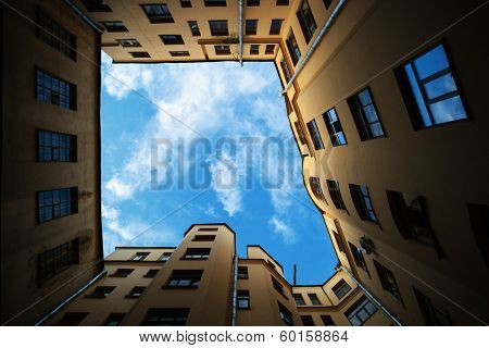 Old city buildings framing sky background