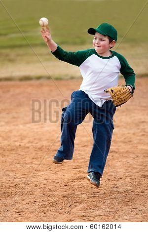 Boy throws baseball during practice