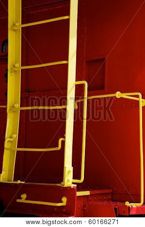 Yellow Ladder On Red Caboose