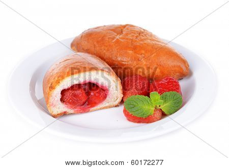 Fresh baked pasties with strawberries isolated on white