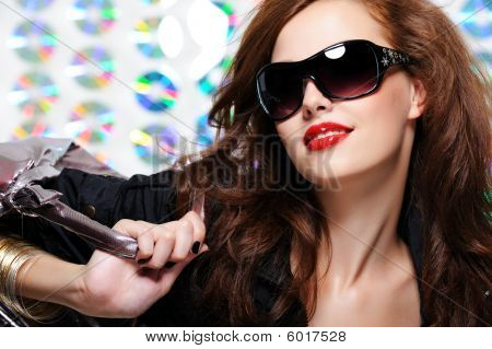 Woman With Fashion Sunglasses And Handbag