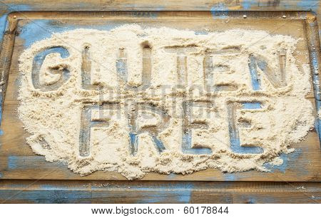 gluten free words written  in coconut  flour on a wooden board