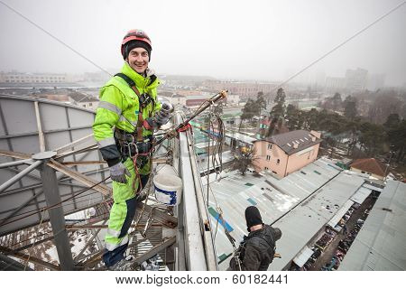 Industrial climber on a metal construction