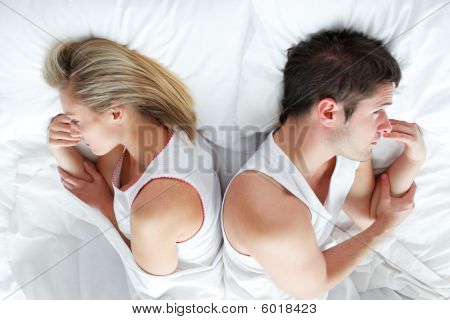 Couple Lying In Bed After Having A Fight. Marriage Trouble