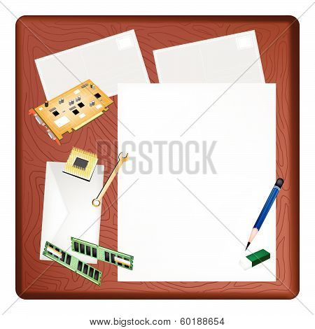 Computer Equipment On A Blank Page And Envelope