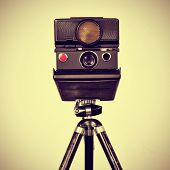picture of selfie  - picture of an old instant camera in a tripod with a retro effect - JPG