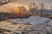 stock photo of early spring  - Misty morning on the river in early spring - JPG