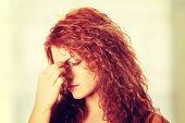 stock photo of fatigue  - Young woman with sinus pressure pain - JPG