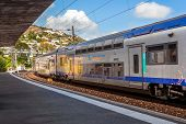 MENTON, FRANCE - JULY 07, 2012: SNCF Ter train departs from station of Menton - popular resort on Fr