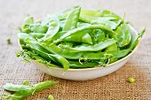 stock photo of snow peas  - Fresh uncooked Snow pea in a bowl - JPG