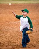 image of hitter  - Boy throws baseball during his t - JPG