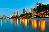 stock photo of waikiki  - Reflections of buildings at Waikiki in the water - JPG