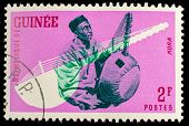 GUINEA CIRCA 1962: stamp printed by Guinea, shows Musical Instrument, Kora, circa 1962