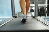 picture of treadmill  - Image of female foot running on treadmill - JPG