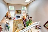 pic of upstairs  - High vaulted ceiling living room with fireplace - JPG