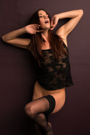 picture of bottomless  - Pretty slender brunette in a black camisole - JPG