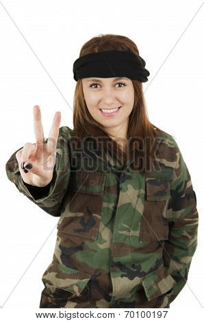 Young happy girl dressed in green camouflage jacket