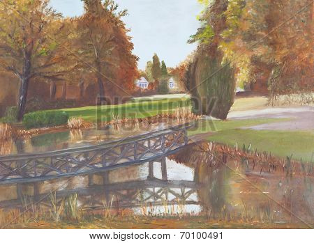 Autumn Forest With A Pond And Bridge Over The Pond