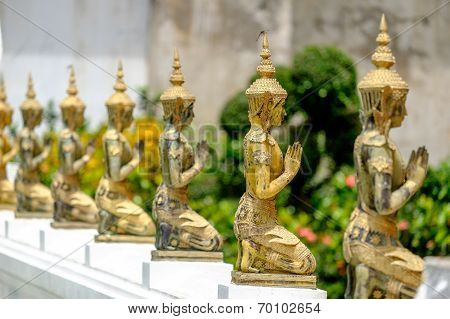 A line of beautiful Buddha statues
