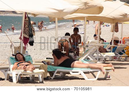 Tourists sunbathing on the beach