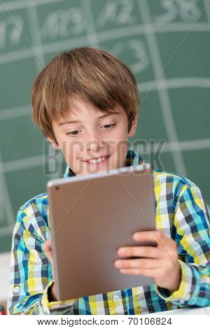 Young Boy Using A Tablet In The Schoolroom