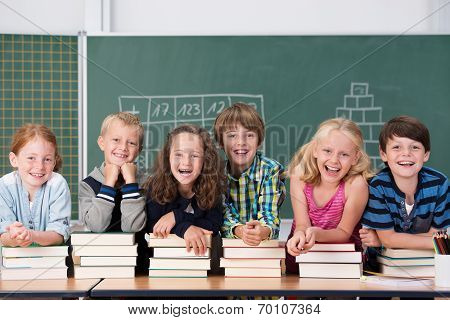 Laughing Group Of Young School Kids In Class