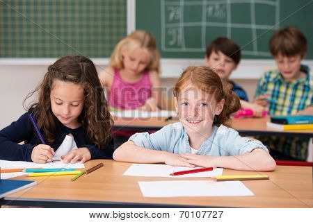 Smiling Pretty Young Redhead Girl In Class