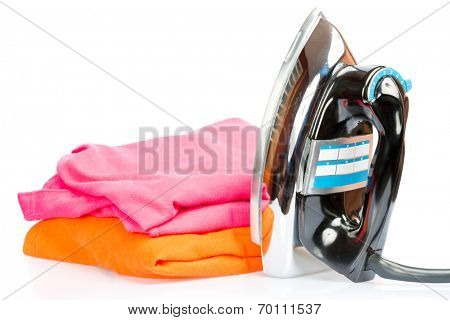 Iron, small home  electrical appliance,  with colorful clothes isolated on a white background