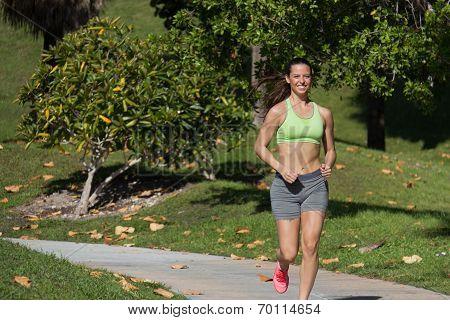 Hispanic Woman Running On A Path