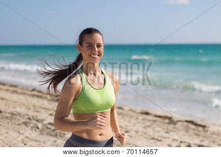 Hispanic Woman Running On The Beach