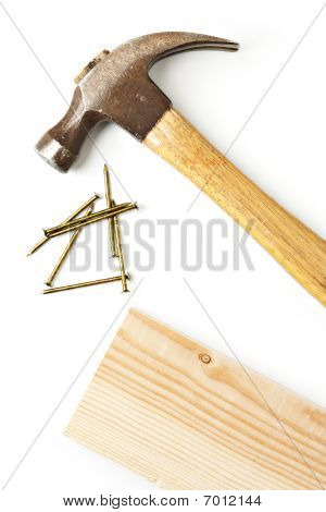 Hammer And Nails With Board Isolated On White.
