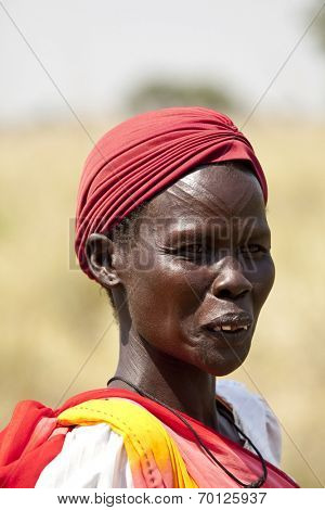 LILIIR, SOUTH SUDAN- DECEMBER 4 2010: Unidentified Dinka woman with tribal scarification in South Sudan