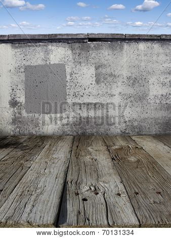 Wooden floorboards and stone wall