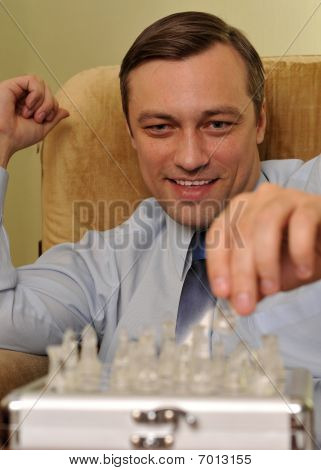 Young Businessman Playing Chess
