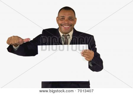 smiling businessman showing board and posing thumbs up