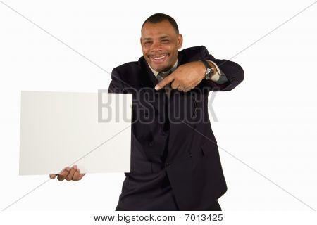 empresario maduro, apuntando a una tabla