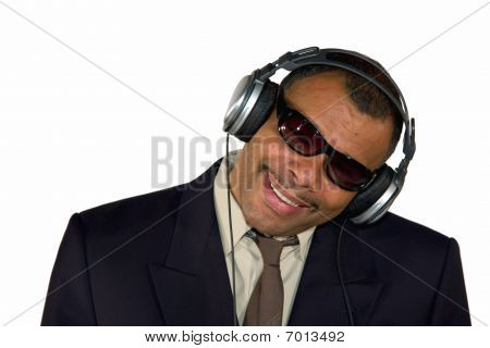 smiling African-American businessman with headphones and sunglasses