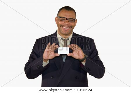 smiling mature African-American businessman presenting card