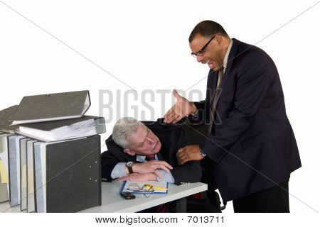 senior businessman being caught by boss while sleeping