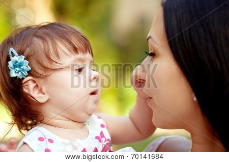 Young happy mother with baby gir
