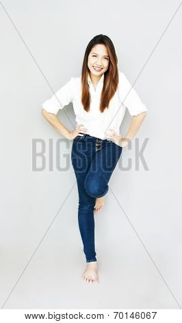 Potrait Asian Lady Smile In Casual Suite ,wear White Shirt And Blue Jeans