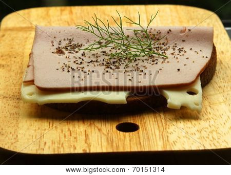 The Pepper And A Sprig Of Dill On The Sandwich